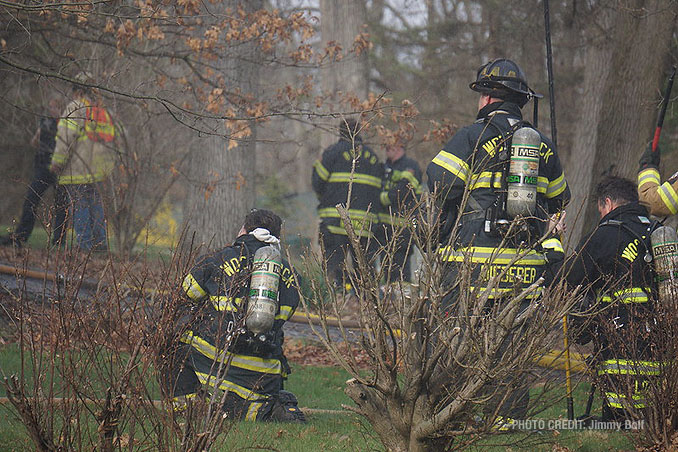 Firefighters awaiting assignments at house fire on Holly Lynn Drive in Cary