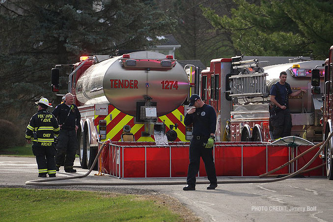 Tender (tanker) operations  at house fire on Holly Lynn Drive in Cary