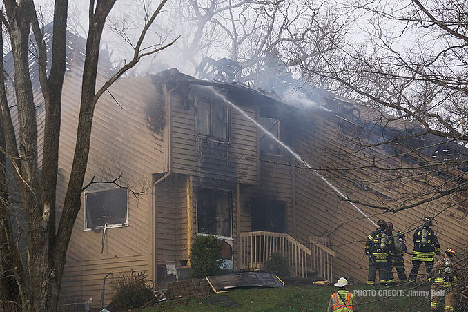 Hand line stream at house fire on Holly Lynn Drive in Cary