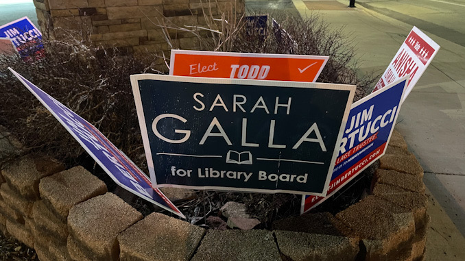 Todd Witherow campaign sign behind Sarah Galla campaign sign