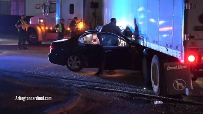 Car crash under semi-trailer on Higgins Road in Elk Grove Village on Wednesday, April 7, 2021