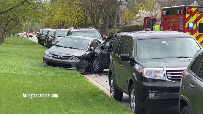 Parked vehicles hit on Oakton Street near Saint Viator in Arlington Heights
