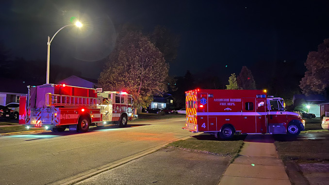 Arlington Heights Fire Department in front of house where a fire pit ignited a patio deck