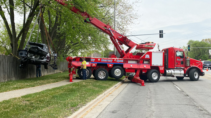 A Toyota SUV lifted over a fence by Hillside Service using a rotator crane tow truck on Monday, May 17, 2021.