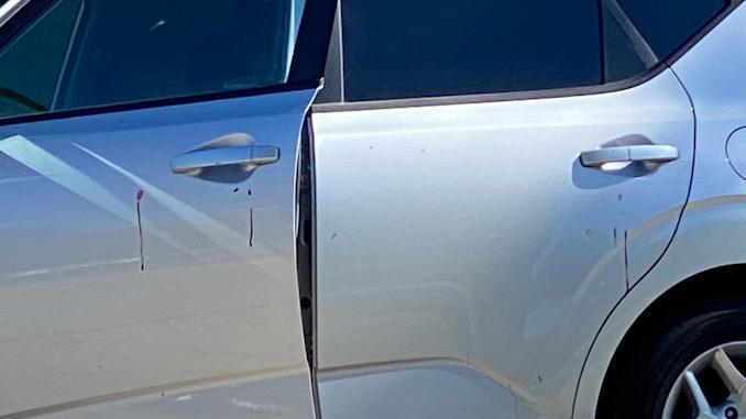 Blood on door handle of silver Kia Soul on Falcon Drive east of Goebbert Road in Arlington Heights