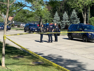 Police planning for case investigation of an aggravated battery on Falcon Drive east of Goebbert Road in Arlington Heights, Saturday, May 29, 2021.