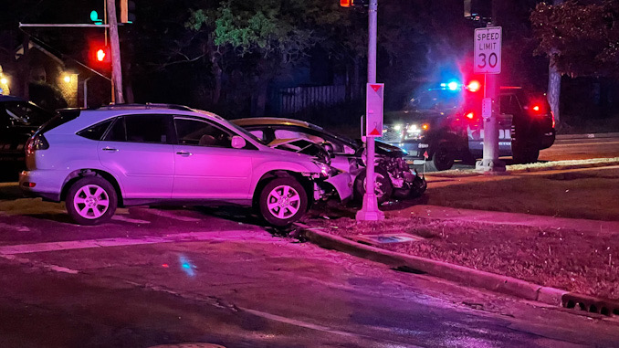 Two of two vehicles involved in a hit-and-run crash where the occupants of the vehicle in the background fled on foot after crashing at Arlington Heights Road an Oakton Street an Arlington Heights Saturday, May 15, 2021