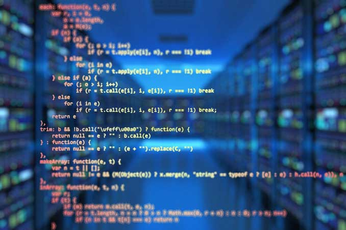 Source code superimposed over a data room or server room at a business.