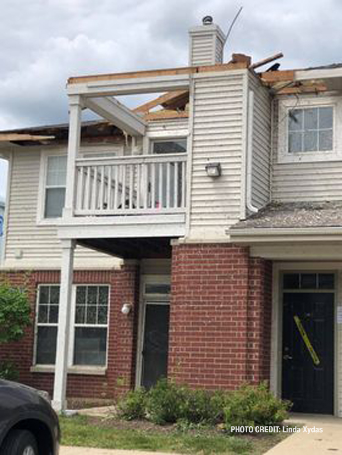 Roof and other damage at The Estates of Thornberry Woods on Gladstone Drive just south of 75th Street near the border of Naperville and Woodridge (PHOTO CREDIT: Linda Xydas)