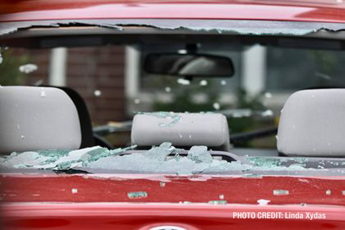 Vehicle damage from a tornado at The Estates of Thornberry Woods on Gladstone Drive just south of 75th Street near the border of Naperville and Woodridge.