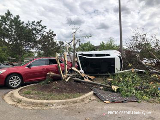 Vehicle flipped with damage from a tornado at The Estates of Thornberry Woods on Gladstone Drive just south of 75th Street near the border of Naperville and Woodridge