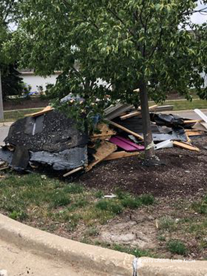 Roof debris on the ground at The Estates of Thornberry Woods on Gladstone Drive just south of 75th Street near the border of Naperville and Woodridge.