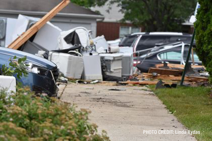 Tornado damage to a storage garage with appliances scattered