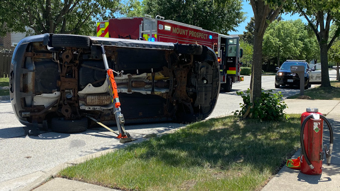 Car vs tree rollover crash on Heritage Drive Mount Prospect