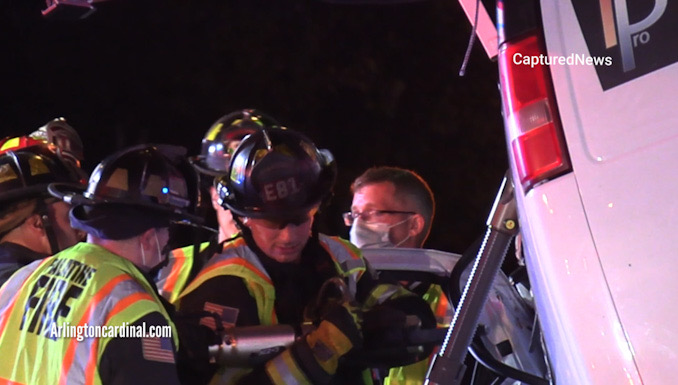 Extrication on the driver's side of a Chevrolet work van with a strut stabilizing the van