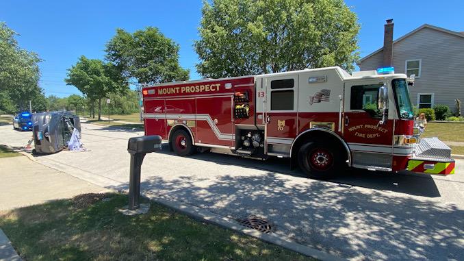 Car vs tree rollover crash on Heritage Drive Mount Prospect.