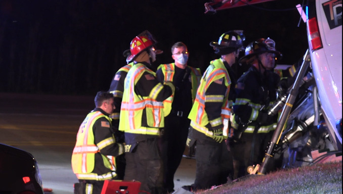 Extrication on the driver's side of a Chevrolet work van with a strut stabilizing the van while another crew was working on the passenger side