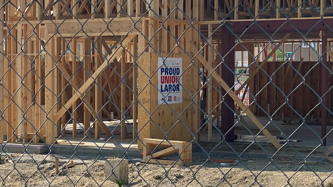 The labor dispute does not involve the Raising Cane's construction site at the outlot near Palatine Road
