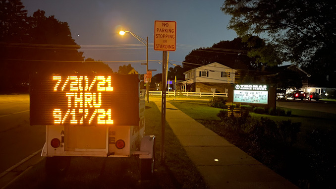 07/20/21 THRU 09/17/21 displayed at sign at Thomas Street and Belmont Avenue in Arlington Heights