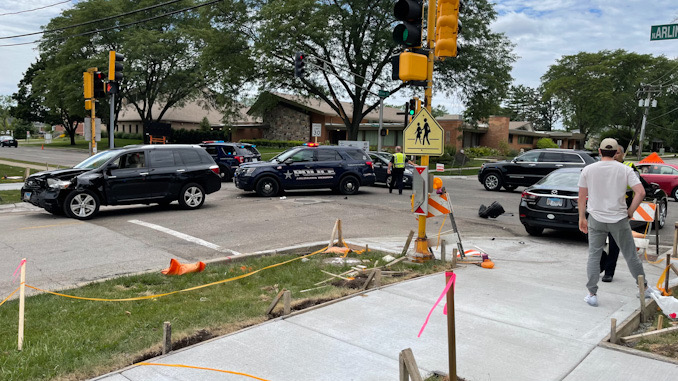 Toyota SUV (left) with left-front damage and Hyundai sedan at Arlington Heights Road and Olive Street on Friday, July 30, 2021.