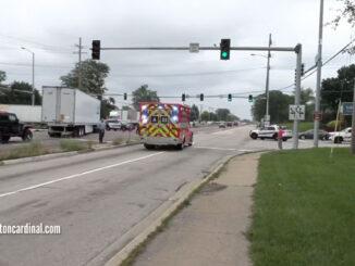 Wheeling Fire Department Ambulance 23 transporting Lexus driver to Glenbrook Hospital, passing crashed semi-trailer truck at Palatine Road and Wheeling Road