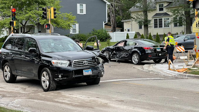 Toyota SUV (foreground) with left-front damage and Hyundai sedan at Arlington Heights Road and Olive Street on Friday, July 30, 2021