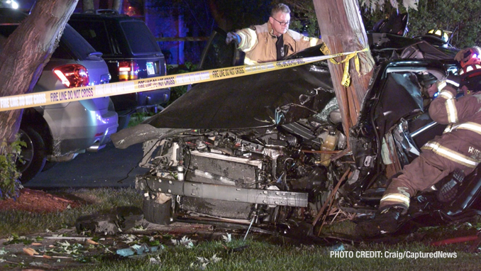 Fatal crash scene shows firefighters working to free occupants of a Dodge Charger that hit a utility pole on Dugdale Road in Waukegan on Saturday, July 24, 2021