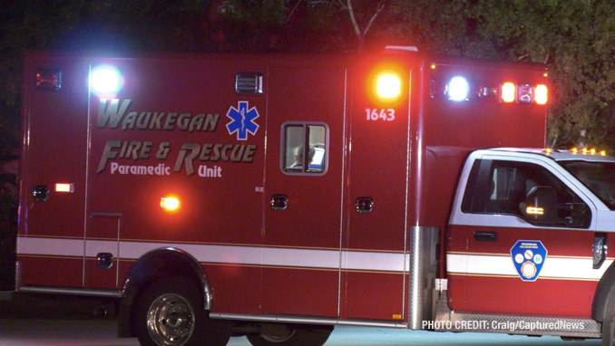 Waukegan Fire Department ambulance at a fatal crash scene after the driver of a Dodge Charger hit a Honda Civic and then a utility pole on Dugdale Road in Waukegan on Saturday, July 24, 2021