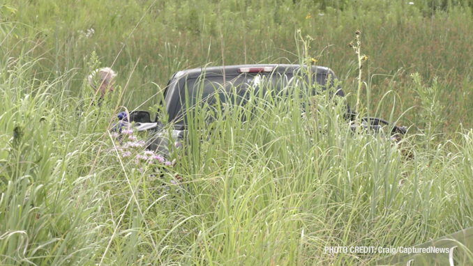 Offender's Chevrolet Silverado stranded in a backyard marsh after he was captured in the Grand Dominion by Del Webb community following a pursuit that started in Wauconda (SOURCE: Craig/CapturedNews)