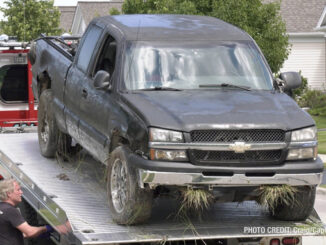 Offender's Chevrolet Silverado on a flatbed tow truck after he was captured in the Grand Dominion by Del Webb community following a pursuit that started in Wauconda (SOURCE: Craig/CapturedNews)