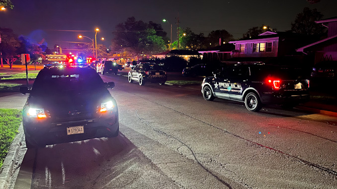 Arlington Heights Police Department SUVs filled the street in the neighbor near the intersection of Palatine Road and Eastwood Drive