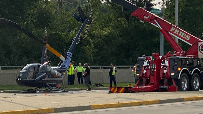 Helicopter uprighted before it was lifted onto a flatbed truck