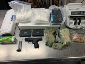 Gun, money bill counter, and scale (SOURCE: Lake County Sheriff's Office)
