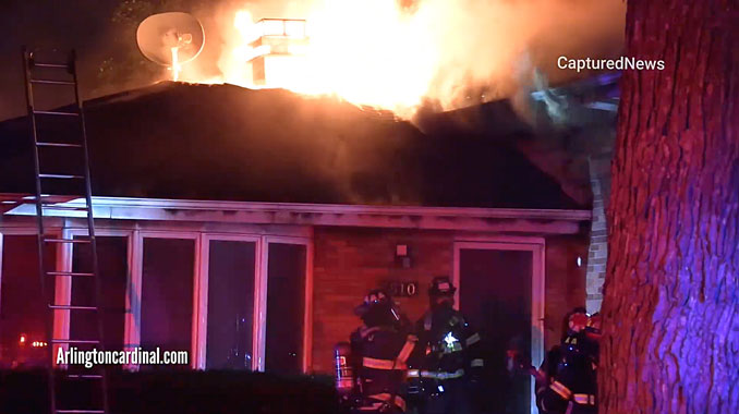 House fire on Mark Drive in Mount Prospect with fire through the roof