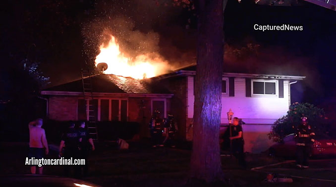 House fire on Mark Drive in Mount Prospect with fire through the roof after chimney collapse.