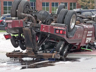 Rollover tow truck crash in Schaumburg at Plum Grove Road and East State Parkway