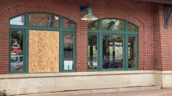 Boarded up window opening where burglars hit the downtown Arlington Heights Metra station at 45 West Northwest Highway