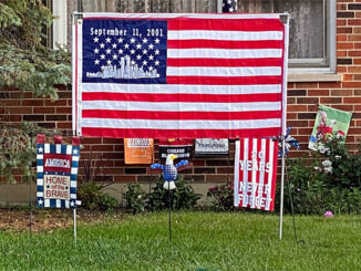 Tribute US flag for September 11, 2001 in front yard at Arlington Heights home