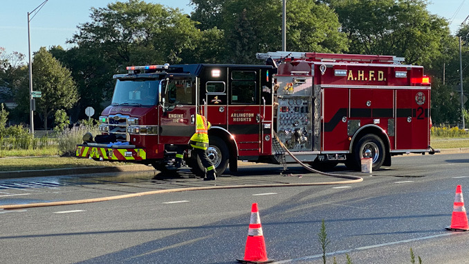 Arlington Heights Fire Department Engine 2 crew standing by with a charged line