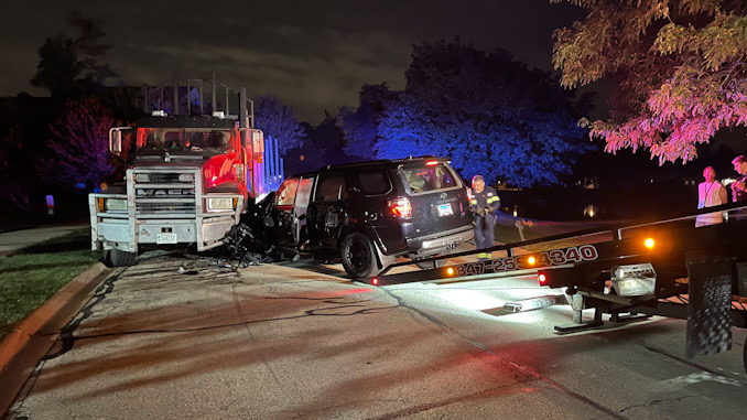 Black Toyota 4Runner crash into a Mack Truck