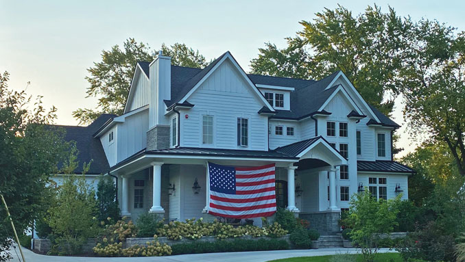 Big US flag displayed at home in Arlington Heights on September 11, 2021