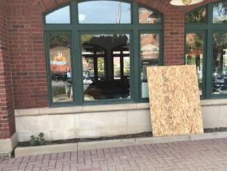 Broken window where burglars hit the downtown Arlington Heights Metra station at 45 West Northwest Highway (PHOTO CREDIT: Jim Emmerson)