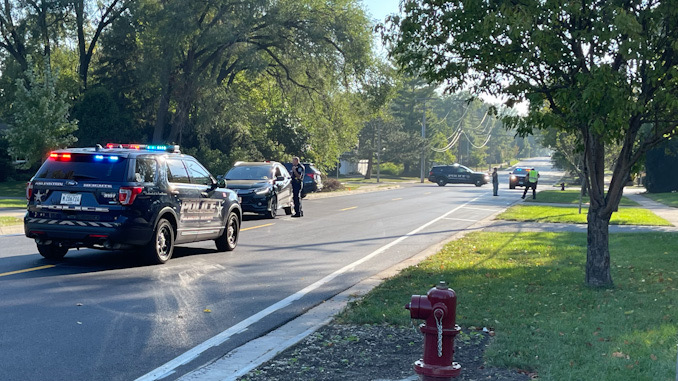 Arlington Heights police officers working at the scene of a hit-and-run pedestrian crash at Thomas Street and Hickory Avenue in Arlington Heights