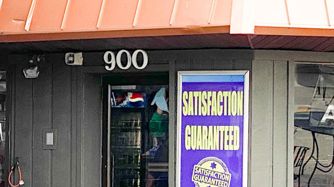 Workers from Suburban Trim & Glass repairing glass door at Northwest Auto Wash after the business was vandalized about 2:40 a.m. Thursday, September 23, 2021