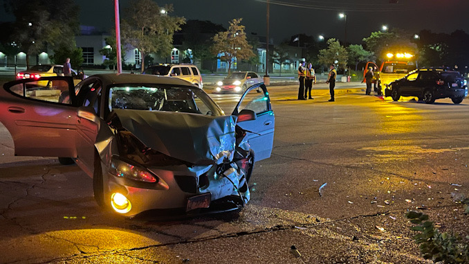 Severely damaged car at a crash scene at Northwest Highway and Euclid Avenue in Arlington Heights