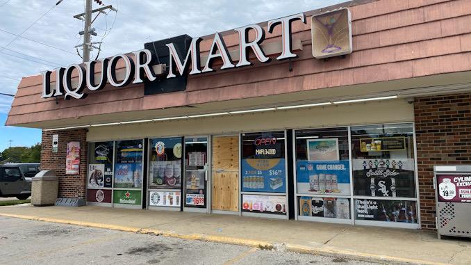 Front glass door smashed at Liquor Mart at 704 East Kensington Road in Arlington Heights
