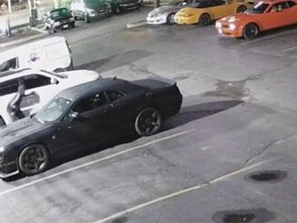 AUTO THEFT IN PROGRESS: Suspect crouching at the scene while auto theft of Dodge Challenger SRT Hellcat is underway (SOURCE: Security video at scene on Harlem Avenue near Addison Street Chicago)