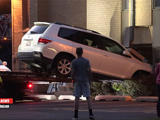 Toyota Highlander removed from church building at the First Baptist Church of Arlington Heights on Campbell Street