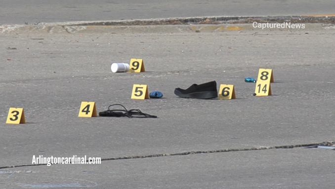 Evidence markers at the scene of a fatal hit-and-run crash on Higgins Road west of Elmhurst Road in Elk Grove Village Wednesday, October 13, 2021
