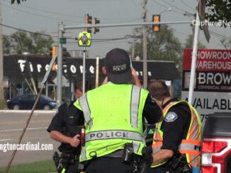 Crash investigators at the scene of a fatal hit-and-run crash on Higgins Road west of Elmhurst Road in Elk Grove Village Wednesday, October 13, 2021